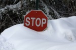 buried-stop-sign-in-bethany