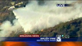 ktla-helicopter-drops-water-on-brush-fire