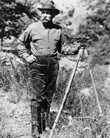 Portrait_of_William_Mulholland_with_a_surveyor's_scope_on_a_tripod,_ca.1908-1913_(CHS-14459)