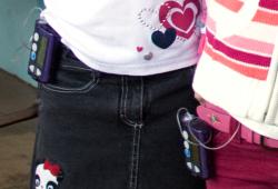 Two young girls wearing insulin pumps.